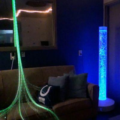 Lights and a lava lamp in a darkene sensory room