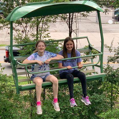 Two girls on sky tram ride